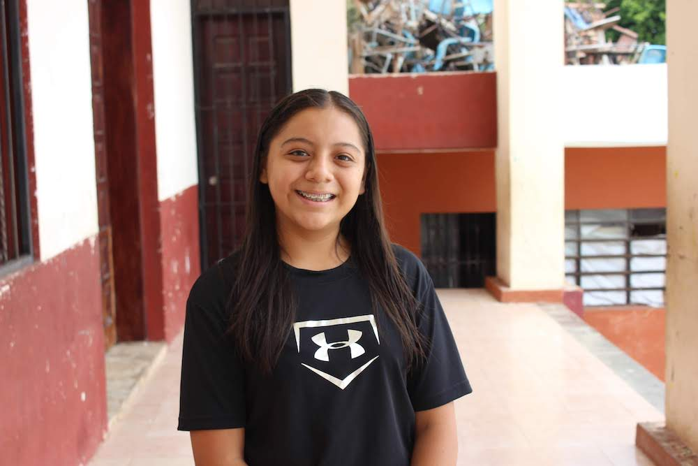 """During her interview, Darina told us, """"I have perseverance. I've faced a lot of challenges, but I am here and I am smiling."""" And that she is. She dreams of becoming a math teacher, and we are so excited to welcome her this summer."""